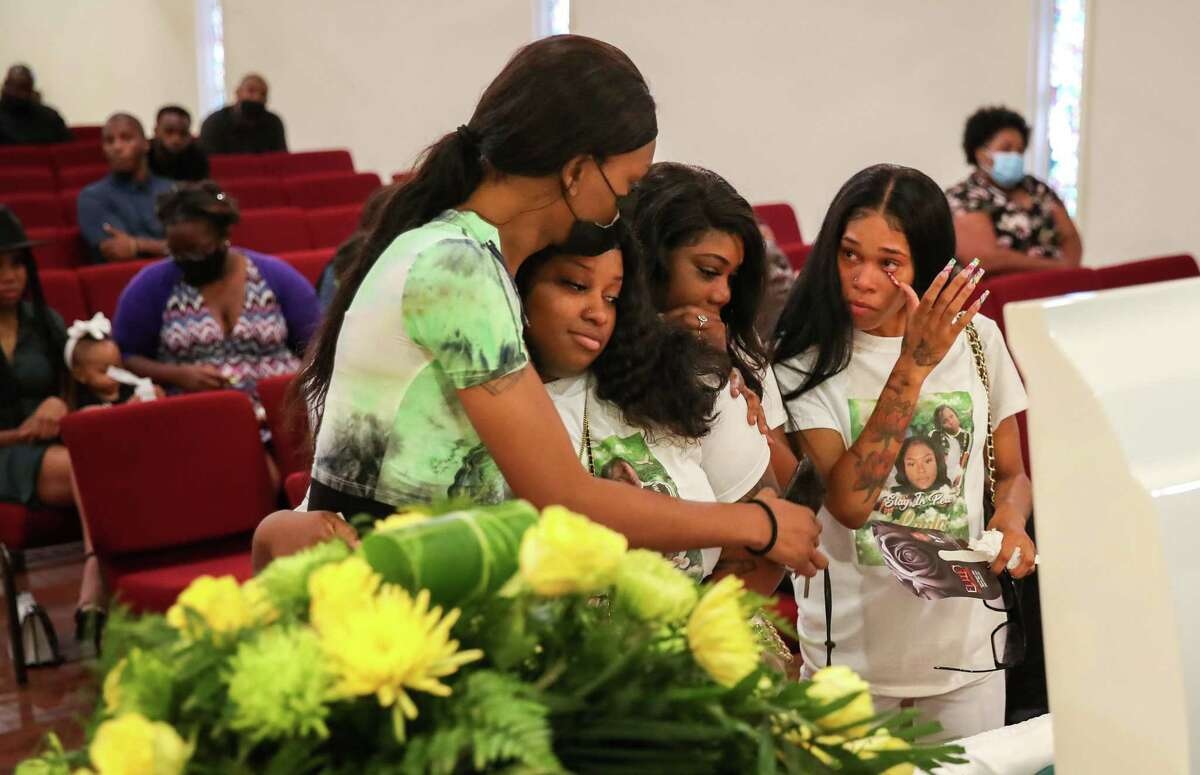 Brielle McCray, from left, Tarsha Mosley, Alexus Ward and Autumn Ramey mourn Layla Steele on Thursday, July 15, 2021, at a celebration of life for Steele in Houston.