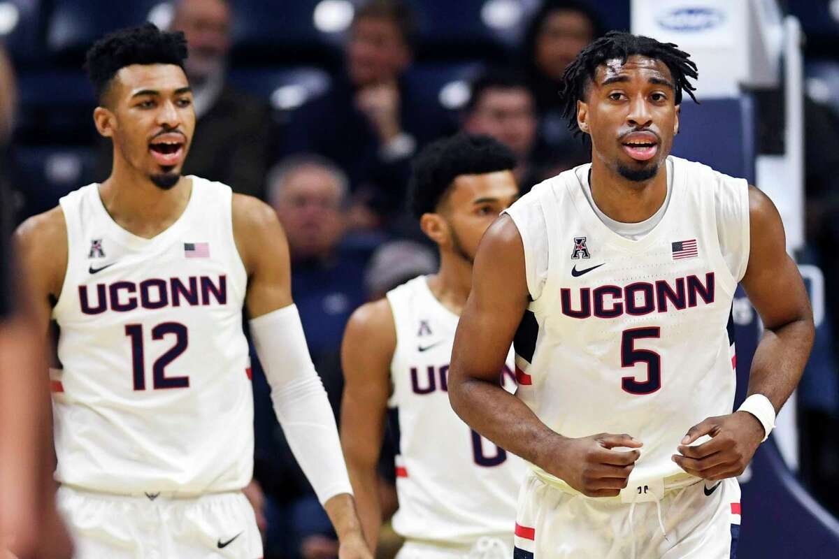 Connecticut's Tyler Polley (12) and Isaiah Whaley (5) head downcourt during the second half of an NCAA college basketball game against St. Joseph's Wednesday, Nov. 13, 2019, in Storrs, Conn. (AP Photo/Stephen Dunn)