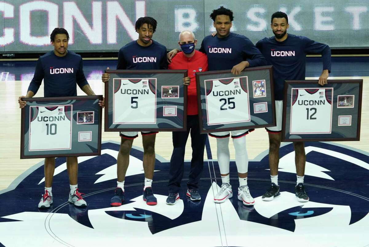 Connecticut guard Brendan Adams (10), forward Isaiah Whaley (5), head coach Dan Hurley, forward Josh Carlton (25), forward Tyler Polley (12) are recognized during senior day before an NCAA college basketball game against Georgetown, Saturday, March 6, 2021, at Harry A. Gampel Pavilion in Storrs, Conn. (David Butler II/Pool Photo via AP)