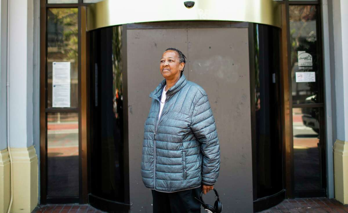 Pamela Tisdale stands outside a hotel where she lives in San Francisco. The hotel has been temporarily leased by the city for homeless people during the pandemic. Tisdale said she has to deal with rats on a daily basis, and also had to recently vacate her room when a pipe burst. The city is preparing to spend an unprecedented $1.1 billion to help people like Tisdale find better housing.
