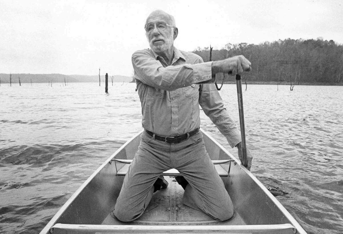FILE-Dr. Benjamin Spock, shown in this1985 file photo rowing a canoe on Beaver lake near his Rogers, Ark., home, died Sunday, March 15, 1998, in San Diego. He was 94. The pediatrician, who as a student was a member of the 1924 Yale University rowing team, helped win the team a gold medal at the 1924 Olympics.
