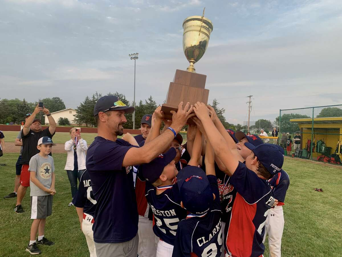 Members of Fraternal Northwest celebrate with the trophy after beating Union Township 10-4 in the Little League Baseball 11-and-under district tournament championship game on Thursday, July 15, 2021.