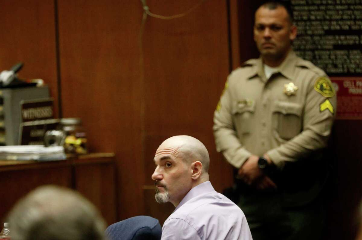 FILE - In this May 29, 2019, file photo, Michael Gargiulo listens to the testimony of actor Ashton Kutcher during Gargiulo's murder trial at Los Angeles Superior Court. Gargiulo has pleaded not guilty to two counts of murder and an attempted-murder charge stemming from attacks in the Los Angeles area between 2001 and 2008, including the death of Kutcher's former girlfriend, 22-year-old Ashley Ellerin. A judge is expected to give a death sentence Friday, Feb. 28, 2020. (Genaro Molina/Los Angeles Times via AP, Pool, File)