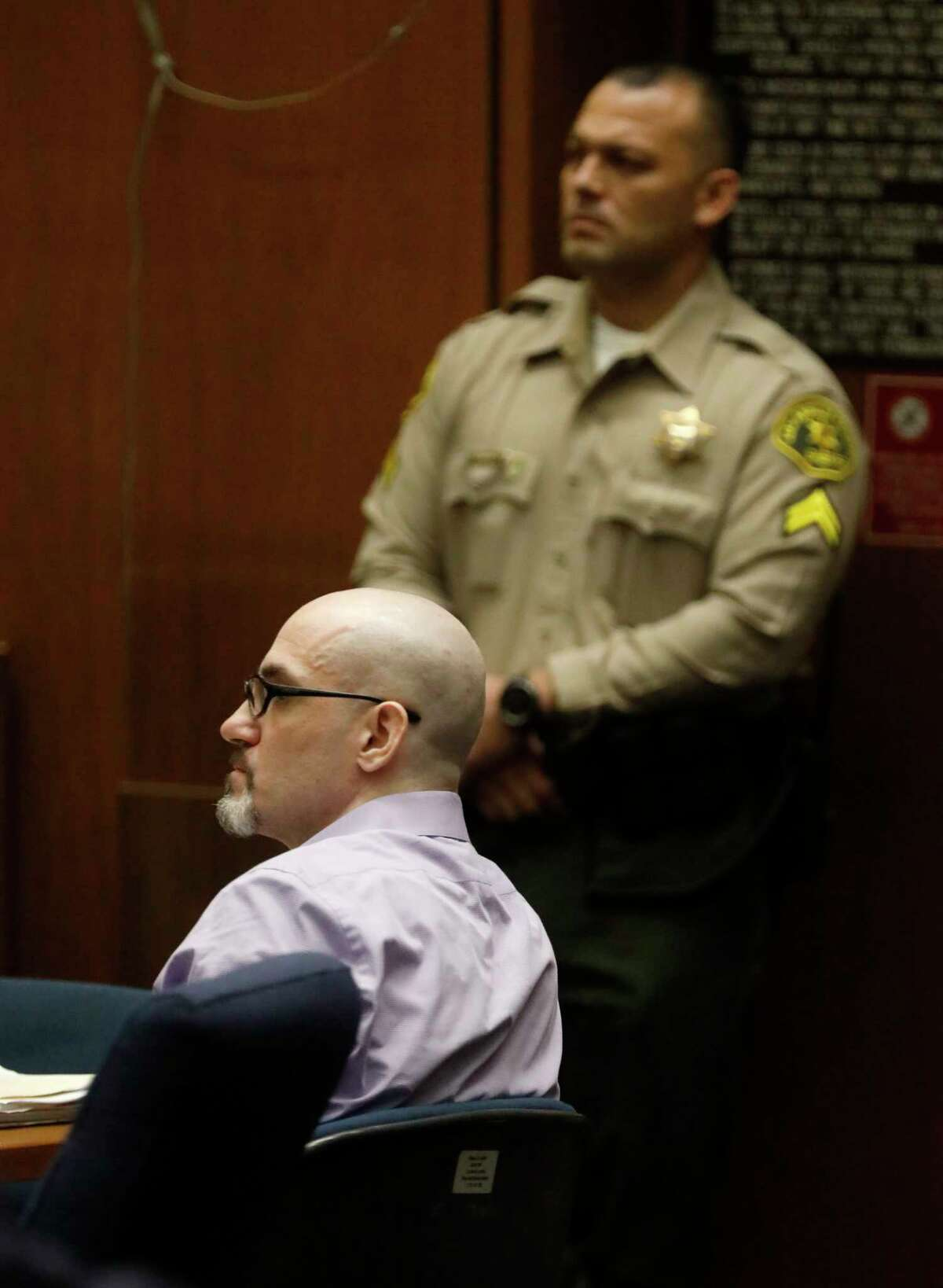 FILE - In this May 29, 2019, file photo, Michael Gargiulo, sitting, listens to the testimony of Ashton Kutcher during Gargiulo's murder trial at Los Angeles Superior Court. Gargiulo has pleaded not guilty to two counts of murder and an attempted-murder charge stemming from attacks in the Los Angeles area between 2001 and 2008, including the death of Kutcher's former girlfriend, 22-year-old Ashley Ellerin. (Genaro Molina/Los Angeles Times via AP, Pool, File)