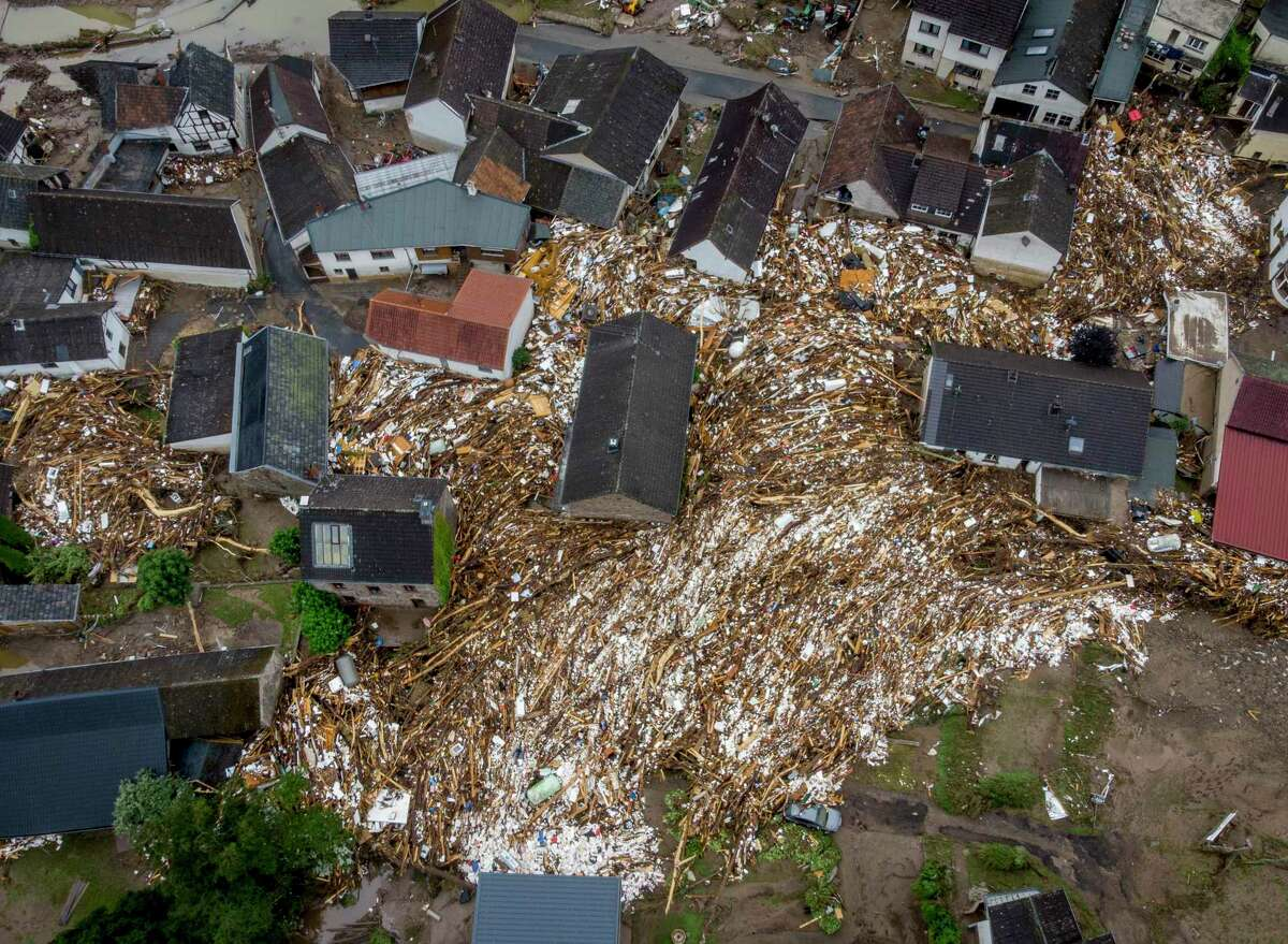 Debris of houses and trees surround houses in Schuld, Germany, Friday, July 16, 2021. Two days before the Ahr river went over the banks after strong rain falls causing severals deaths and hundreds of people missing.