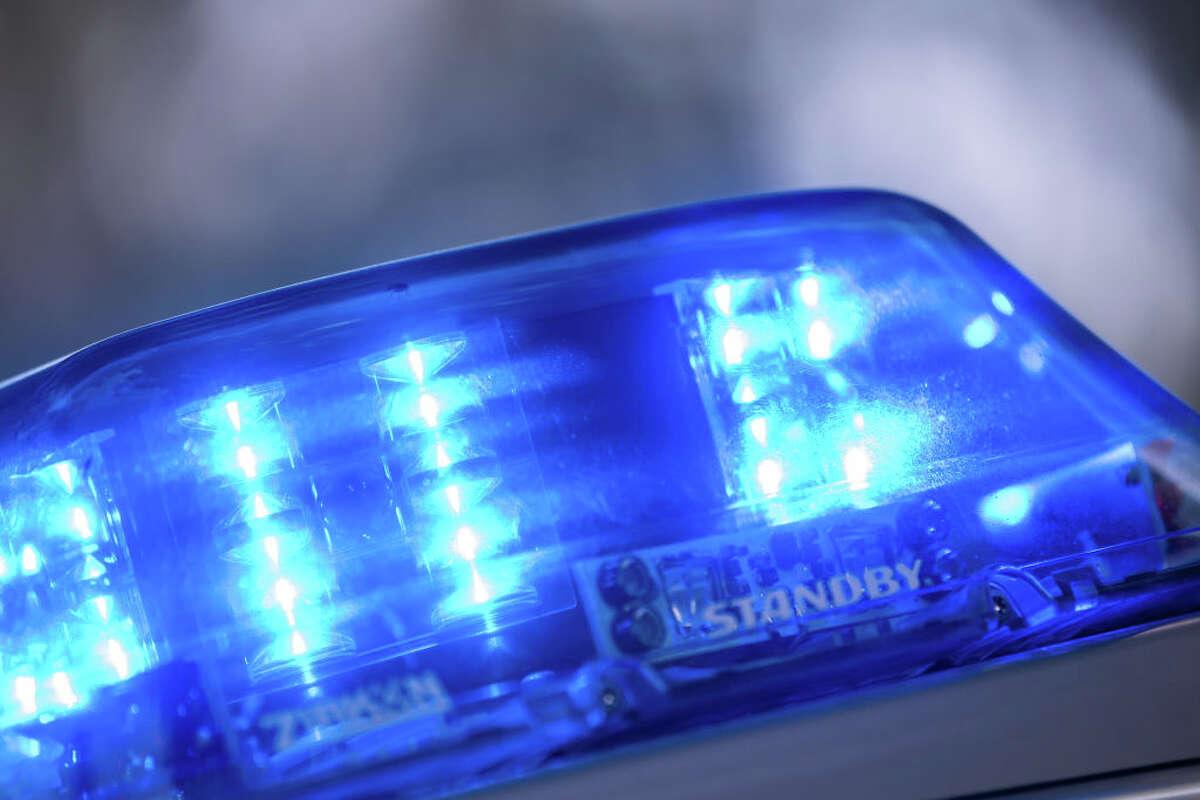 Blue lights shining on a police car