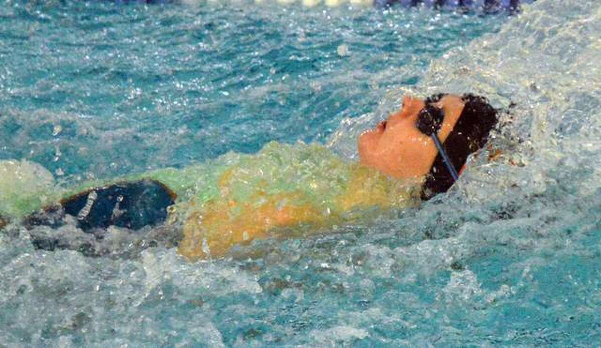 Edwardsville's Allison Naylor competes in the 100-yard backstroke during the Edwardsville Sectional on Oct. 24 at Chuck Fruit Aquatic Center.