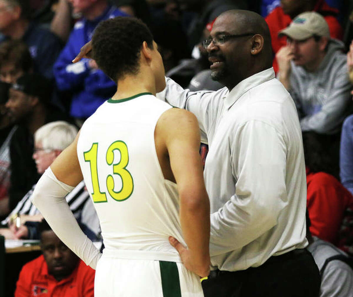 Metro-East Lutheran coach Anthony Smith talks to his son and Knights star AJ Smith (13) during a game in the 2019-20 season at Hooks Gym in Edwardsville. Smith is the 2021 Telegraph Small-Schools Boys Basketball Coach of the Year.