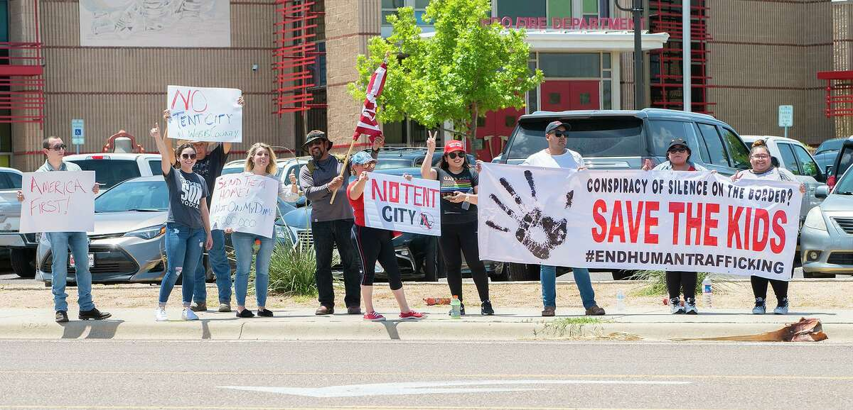"""Protesters share their opposition to a """"tent city"""" in Laredo on Thursday, July 15, 2021, outside the City of Laredo Fire Department and Administration Center during a week where local leaders spoke about an upcoming migrant facility to be built at the fairgrounds."""