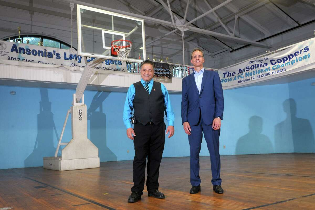 Mayor David Cassetti, left, poses with Pat Charmel, President and CEO of Griffin Hospital in the gymnasium of the Ansonia Armory, in Ansonia, Conn. July 14, 2021.