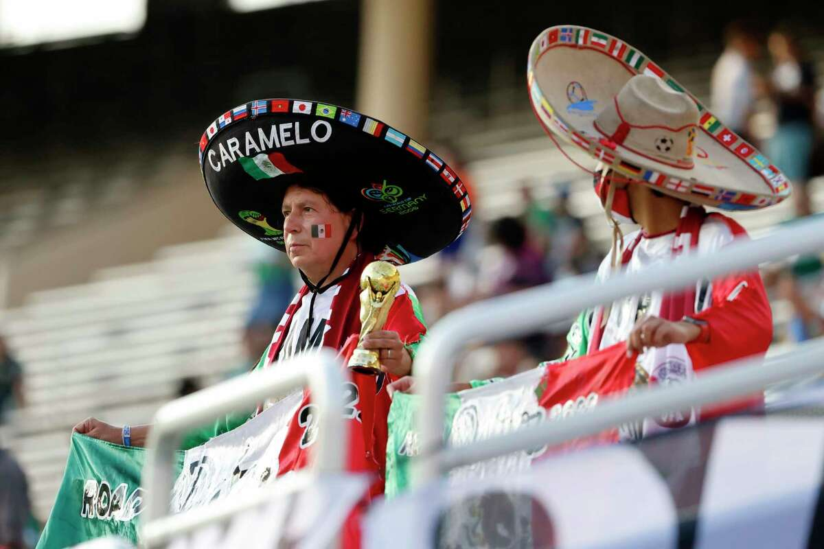 Mexico fans show their support prior to playing Guatemala during a CONCACAF Gold Cup Group A soccer match in Dallas, Wednesday, July 14, 2021. (AP Photo/Michael Ainsworth)
