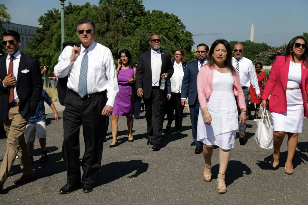 Texas House Democrats arrive for a news conference outside the U.S. Capitol on Tuesday. A reader calls their efforts to block a voting restrictions bill an embarrassment.