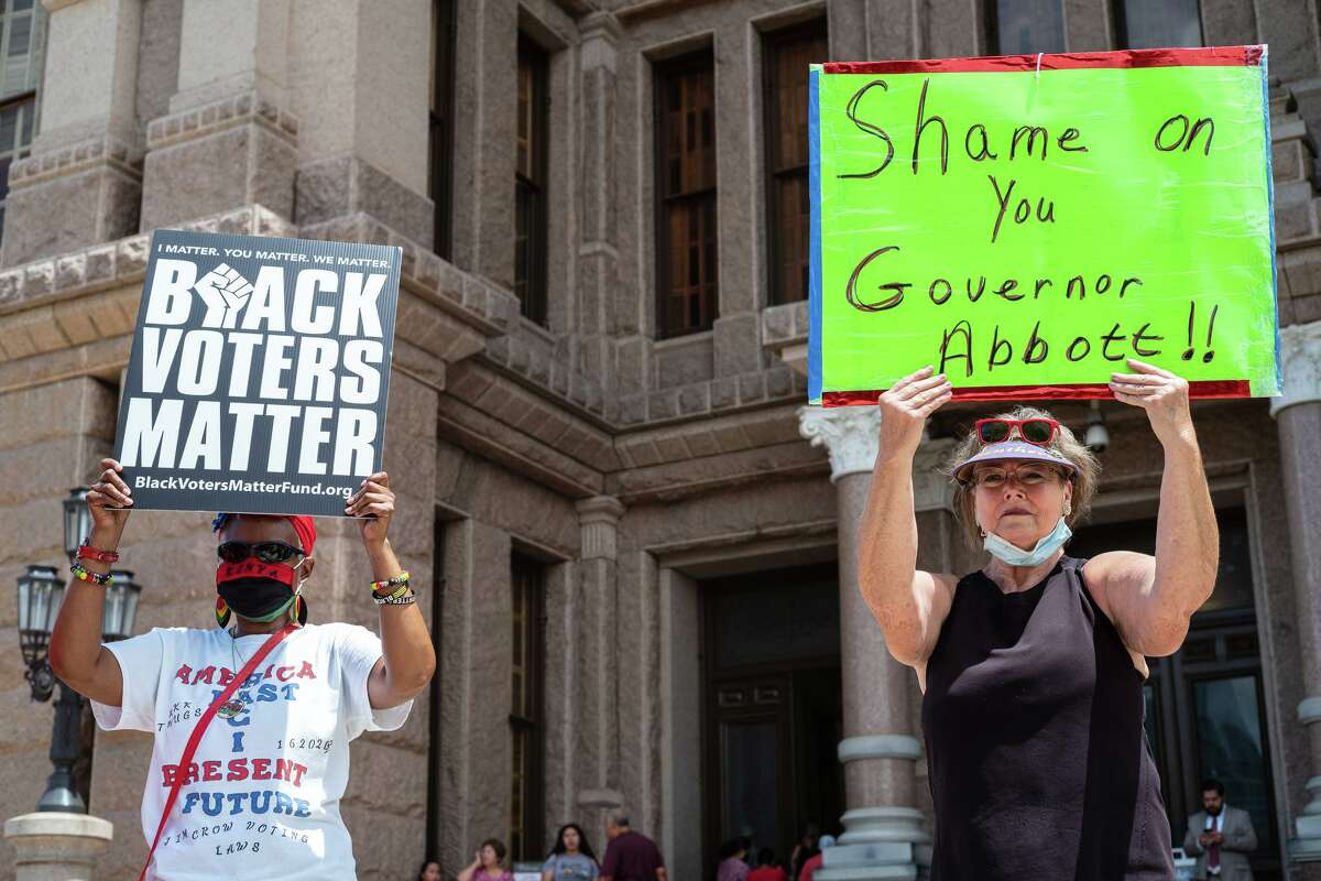 Demonstrators gather outside of the state Capitol on the first day of the 87th Texas Legislature's special session to denounce voter restriction and bills banning the teaching of Critical Race Theory in public schools.