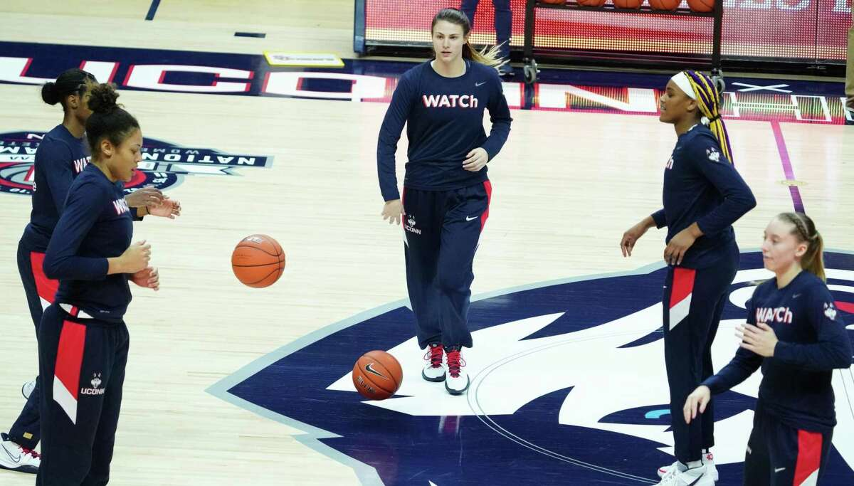 UConn freshman Saylor Poffenbarger (center) warms up before a Feb. 3 game against St. John's at Gampel Pavilion.