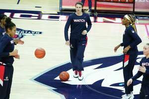 Feb 3, 2021; Storrs, Connecticut, USA; UConn Huskies guard Saylor Poffenbarger (center) warms up with her teammates before the start of the game against the St. John's Red Storm at Harry A. Gampel Pavilion. Mandatory Credit: David Butler II-USA TODAY Sports