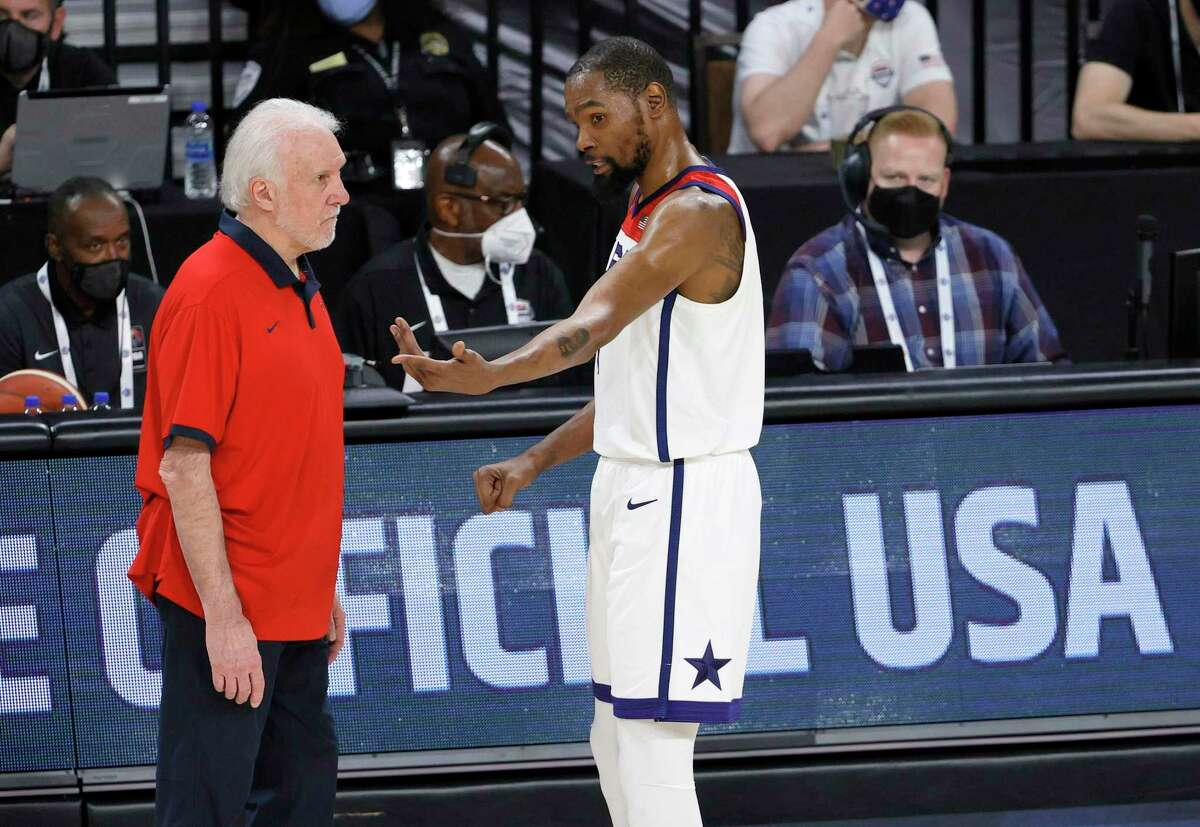 Head coach Gregg Popovich of the United States talks with Kevin Durant (7) during an exhibition game against Nigeria at Michelob ULTRA Arena ahead of the Tokyo Olympics on Saturday, July 10, 2021, in Las Vegas, Nevada.