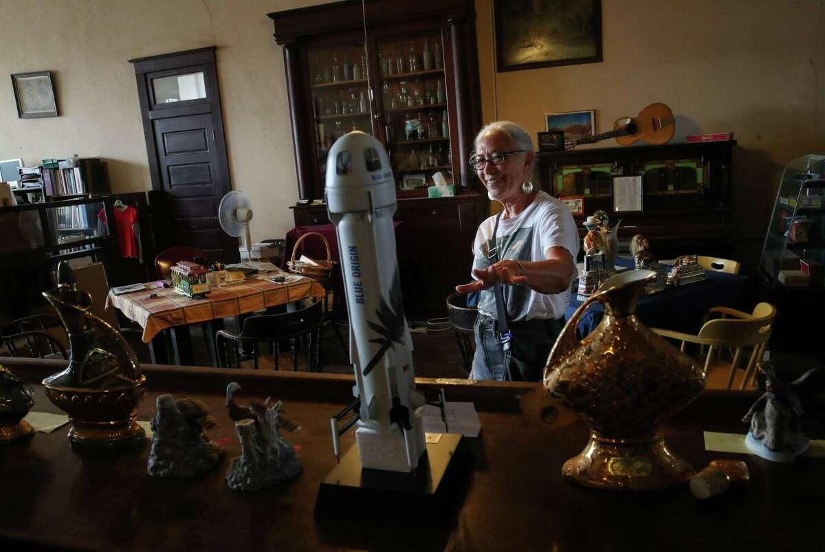 Patricia Golden talks about the Blue Origin rocket Tuesday, June 29, 2021, at the Clark HotelHistorical Museum in Van Horn.