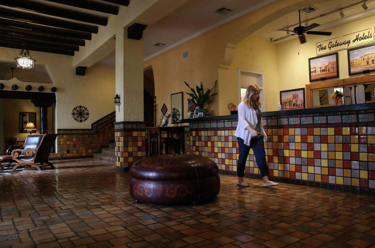 """Starvanna Cottrell walks through the lobby of Hotel El Capitan on Tuesday, June 29, 2021, in Van Horn. """"I always like to say that Van Horn, we're the frontier of agriculture and railroad,"""" she said. """"But now we've become like this frontier of space."""""""