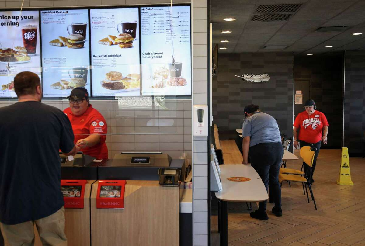 A feather is seen in the lobby of a McDonald's restaurant Friday, July 2, 2021, in Van Horn. Blue Origin gave feathers to local businesses.