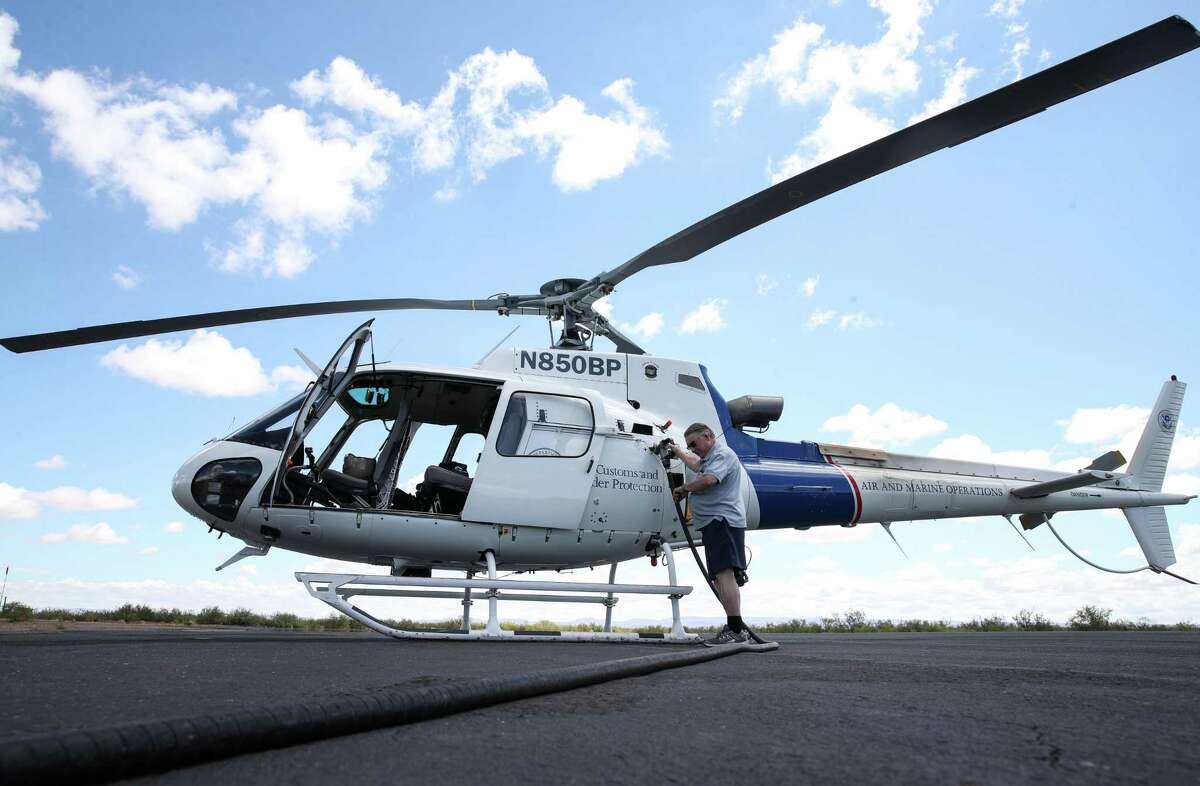 Larry Simpson fuels a Customs and Border Protection helicopter Thursday, July 1, 2021, in Van Horn. Simpson, former owner of the town's newspaper, now runs a business providing fuel to aircraft at the airport as well as an office supply store.