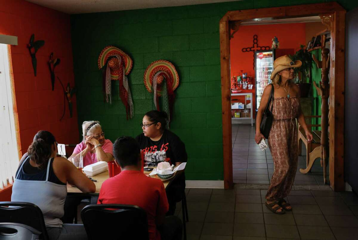 Michelle Yglecias, center, talks with her aunt Sofia Seymour, left, and two family members as they eat lunch Thursday, July 1, 2021, at Lizy's Restaurant in Van Horn.