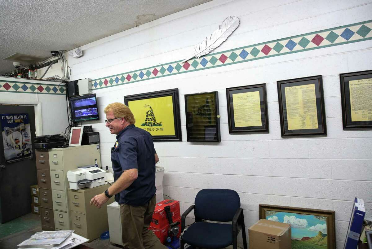 """Vance Cottrell walks past a Blue Origin feather in his office Wednesday, June 30, 2021, at a NAPA auto parts store in Van Horn. The feather was one of several given out to local businesses. Cottrell said that about a quarter of the store's business was because of Blue Origin or its contractors. """"It sure has made the job a lot more fun,"""" he said. """"I'm a rocket guy now."""""""