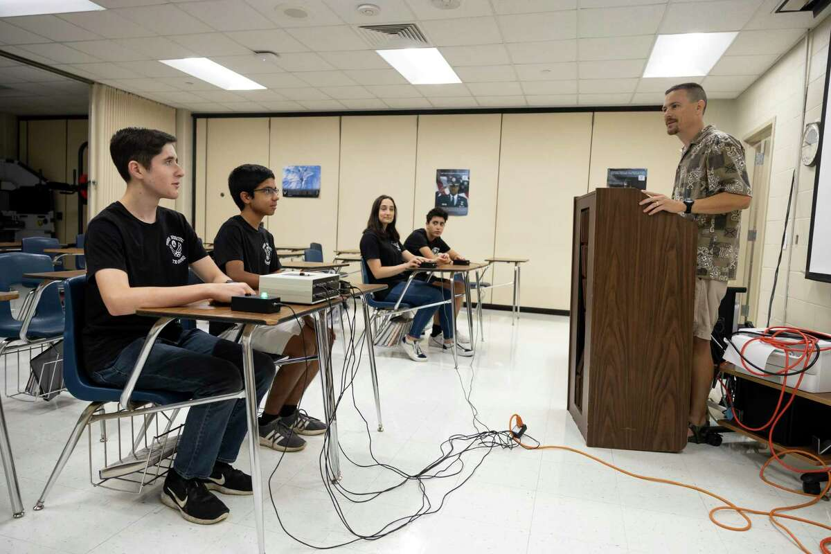 """Lt. Col. """"Chris"""" McMartin, right, leads a mock academic bowl with The Woodlands Air Force JROTC at The Woodlands High School, Thursday, July 15, 2021, in The Woodlands. TWHS Air Force JROTC will be competing at the national academic bowl in Washington D.C. the weekend of July 24th where they will compete against 15 other teams."""