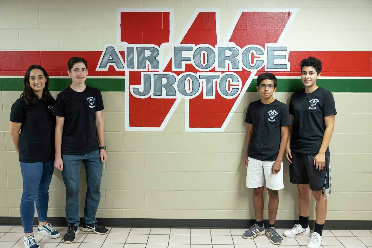 From left to right, Isabella Griffo, Spencer Snarr, Lucas Mohler and Isa Devia, members of The Woodlands High School Air Force JROTC, pose for a portrait at The Woodlands High School, Thursday, July 15, 2021, in The Woodlands. TWHS Air Force JROTC will be competing at the national academic bowl in Washington D.C. the weekend of July 24th where they will compete against 15 other teams.