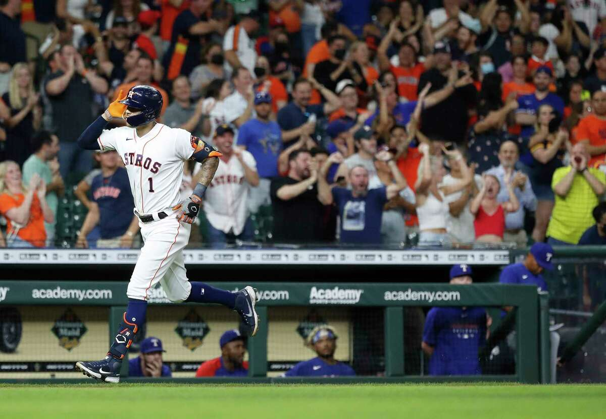 Houston Astros shortstop Carlos Correa (1) reacts after hitting a home run off of Texas Rangers pitcher Josh Sborz during the ninth inning of an MLB baseball game at Minute Maid Park, Tuesday, June 15, 2021, in Houston.