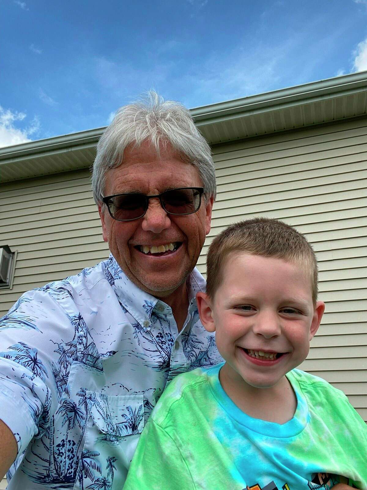 Chuck McCourt, left, is pictured with one of his grandsons. (Photo provided)