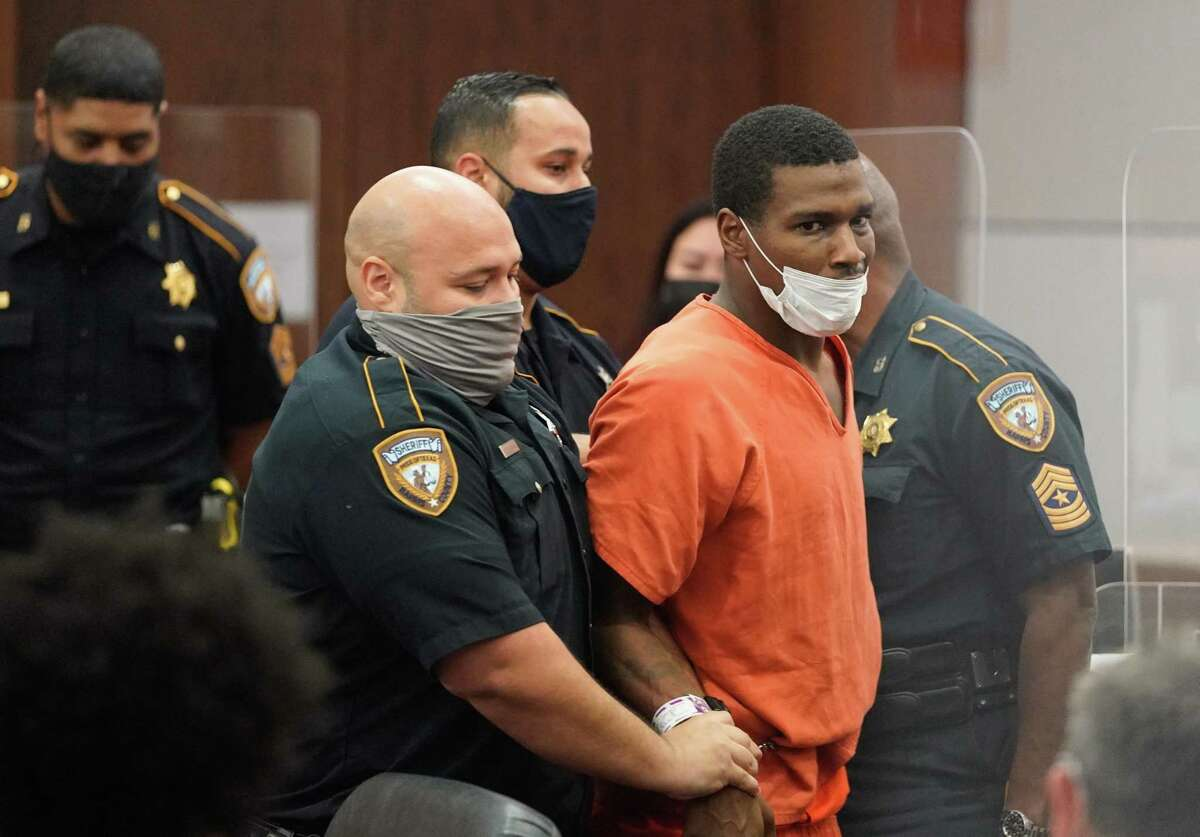 Zacchaeus Rashad Gaston struggles with deputies during an appearance in the Harris County 351st District Court Friday, July 16, 2021 charged in the July 1 death of Layla Steele, 24, while out on seven bonds in Harris County.