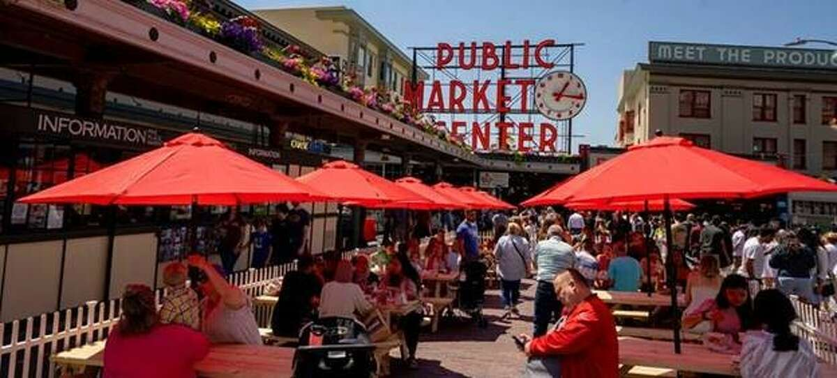 New outdoor seating at Pike Place Market features picnic tables with umbrellas.
