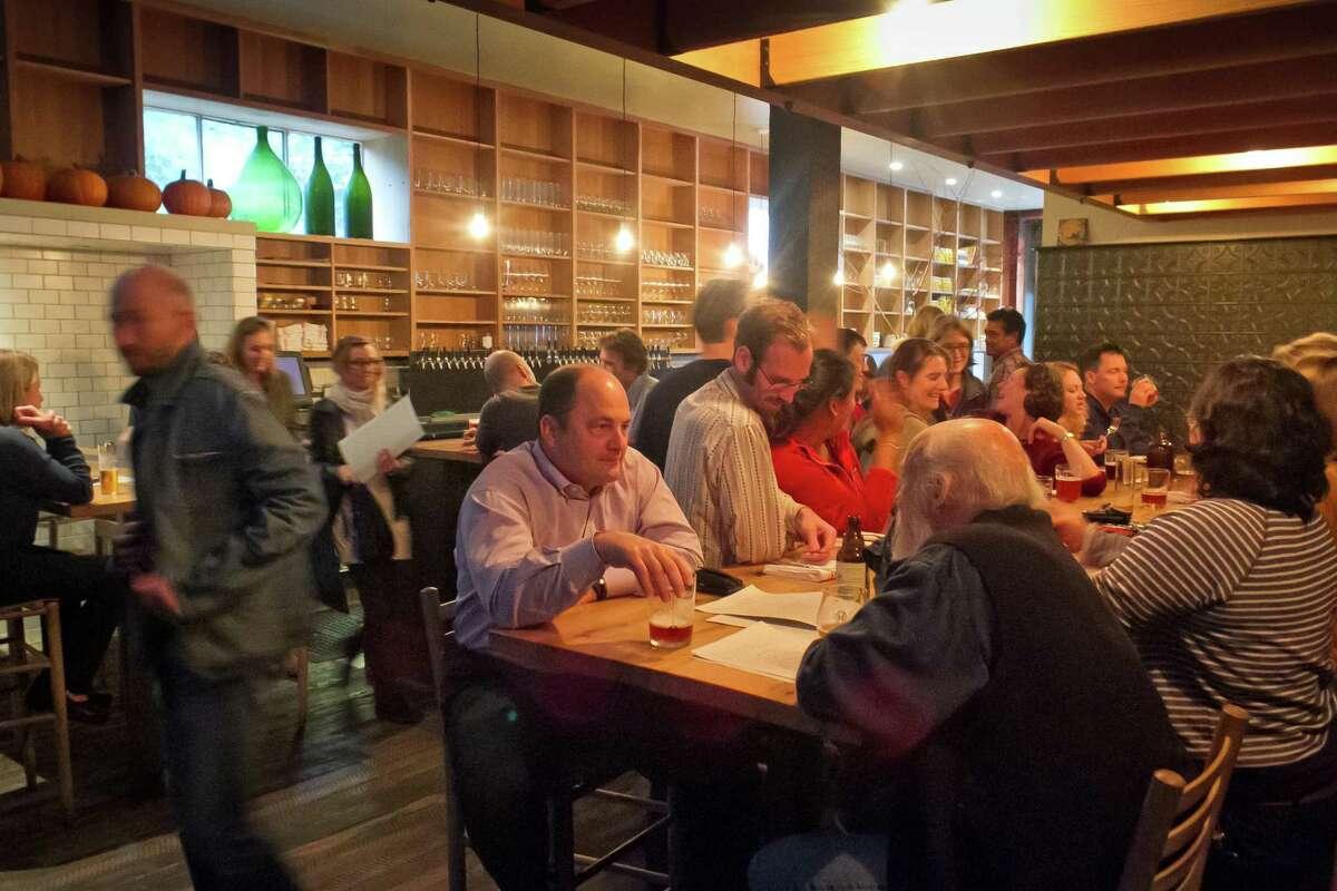 People enjoy dinner at Mill Valley Beerworks in 2012.