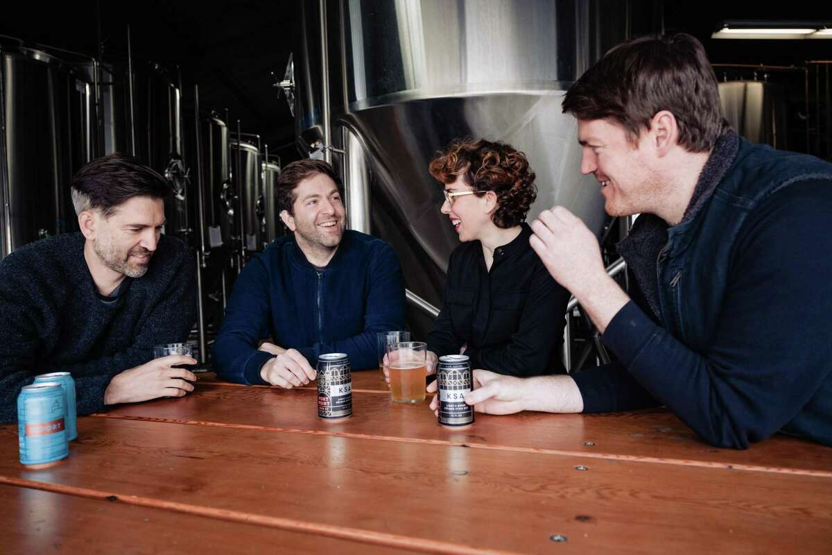 The original Fort Point Brewery team from left to right, Cofounders Tyler and Justin Catalana, creative director Dina Dobkin and Director of brewing Mike Schnebeck and chat over a few beers at the Fort Point Brewery in San Francisco, Calif. on Sunday, January 26, 2020.