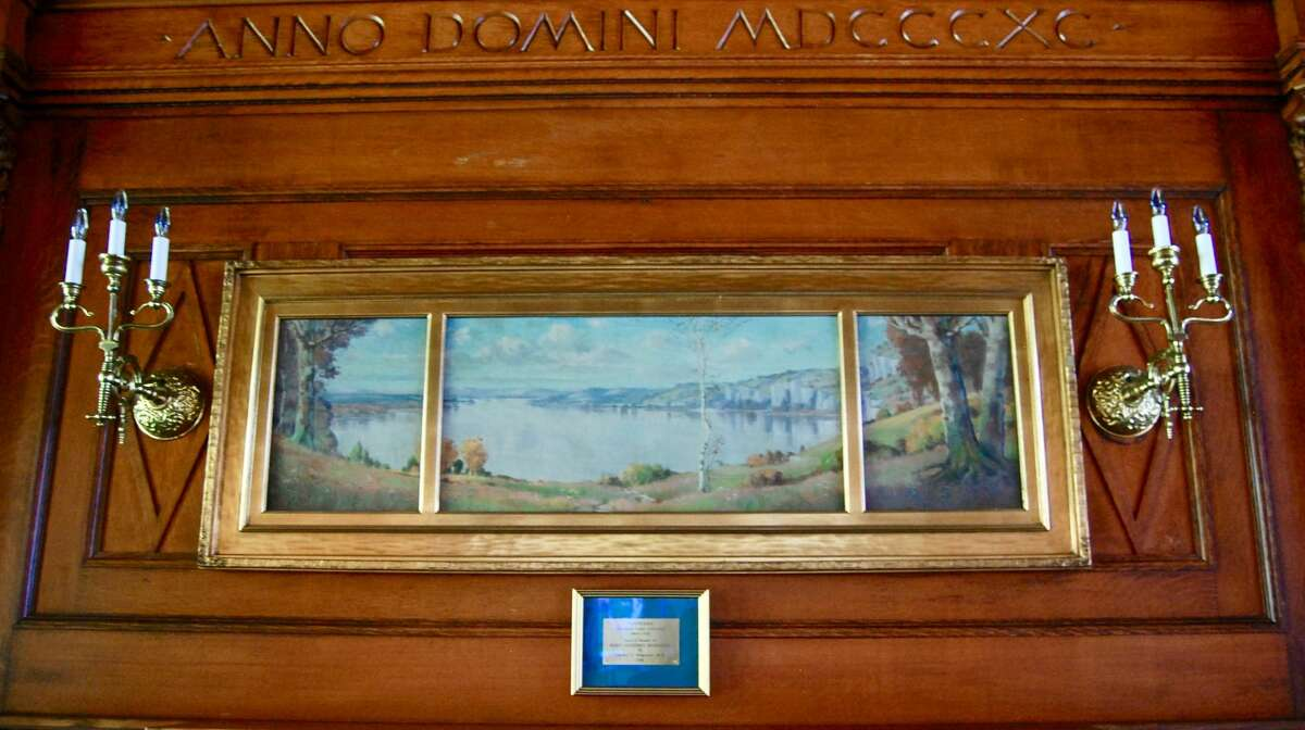 """""""River Landscape"""":This painting is by famed artist Fredrick Oakes Sylvester. He is best known as the painter of the Eads Bridge in St. Louis. He painted many depictions of the Mississippi River. This particular panoramic painting is the view of the great river from his home located between Alton and Grafton in Elsah, Illinois. Sylvester's work earned him a bronze medal at the 1904 World's Fair. He loved the river so much that upon his death at the age of 45 in 1915, his ashes were scattered at the confluence of the Missouri and Mississippi rivers respectively."""