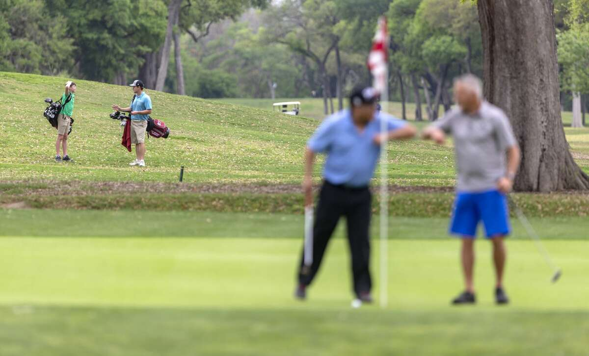 A pair of golfers, left, walk the Brackenridge golf course in 2020. The municipal course was recently named one of the best in the country by Golf Magazine.