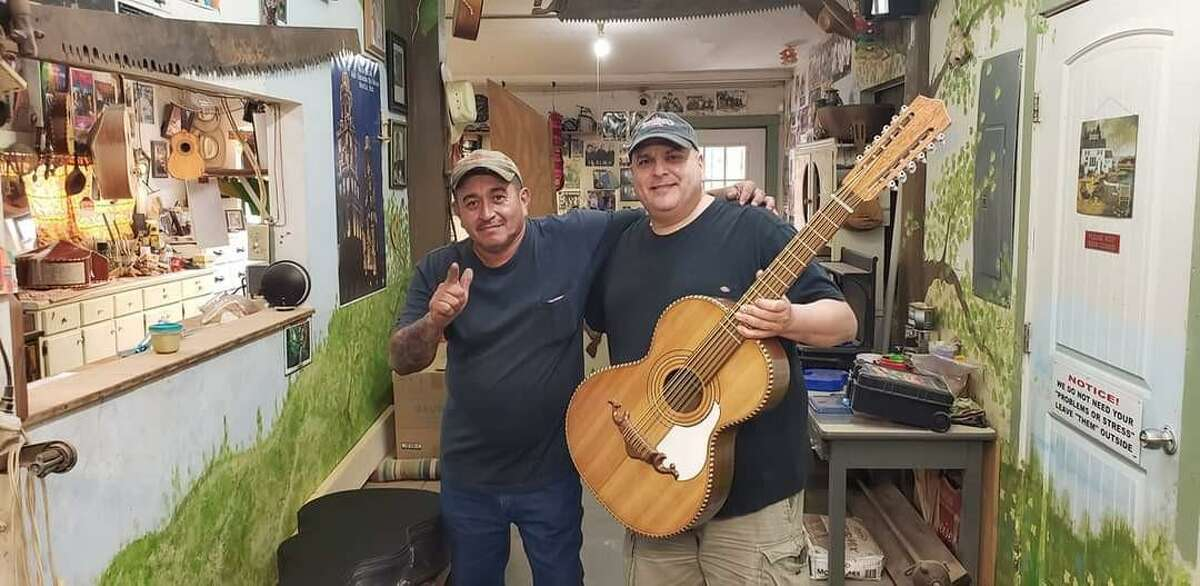 Los Texmaniacs frontman Max Baca picks up his newly made bajo sexto built by third-generation luthier luthier George Macias in Macias' southwest side workshop in 2020. In 2019, Baca sold a bajo made in 1972 by Macias' grandfather Martin Macias to the Smithsonian's National Museum of American History.