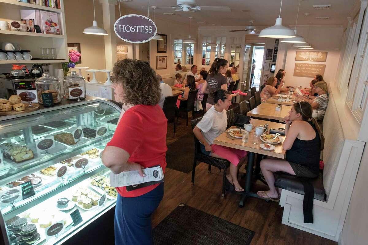 Customers enjoy a meal in Sweet Mimi's on Friday, July 16, 2021 in Saratoga Springs, N.Y. (Lori Van Buren/Times Union)