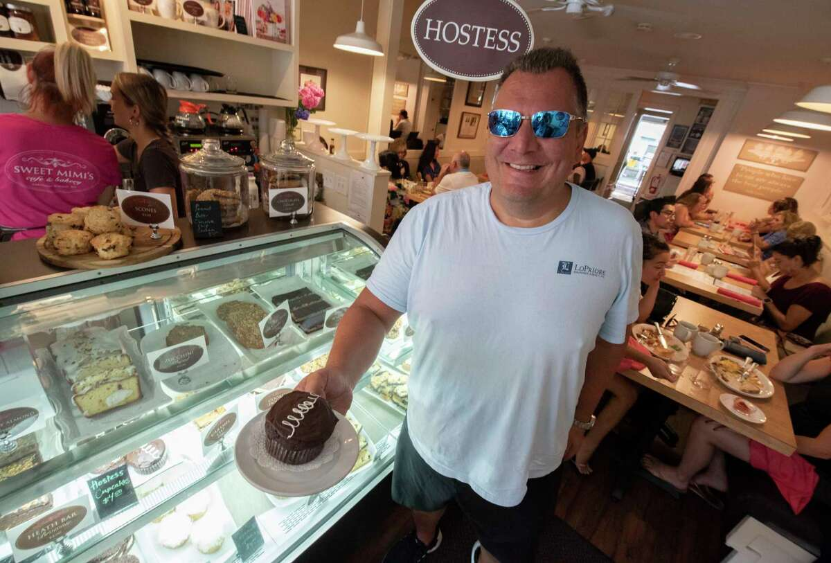 John LoPriore of Boston holds a made-from-scratch version of a Hostess cupcake he ordered in Sweet Mimi's on Friday, July 16, 2021 in Saratoga Springs, N.Y. (Lori Van Buren/Times Union)