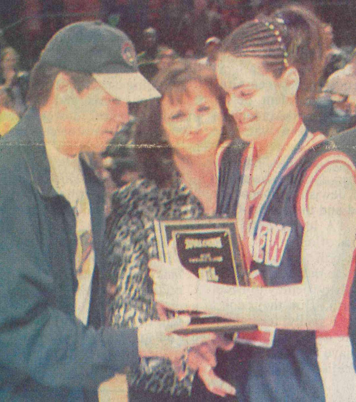 Alesha Robertson receives the MVP trophy after the Lady Dogs' 2002 state championship victory