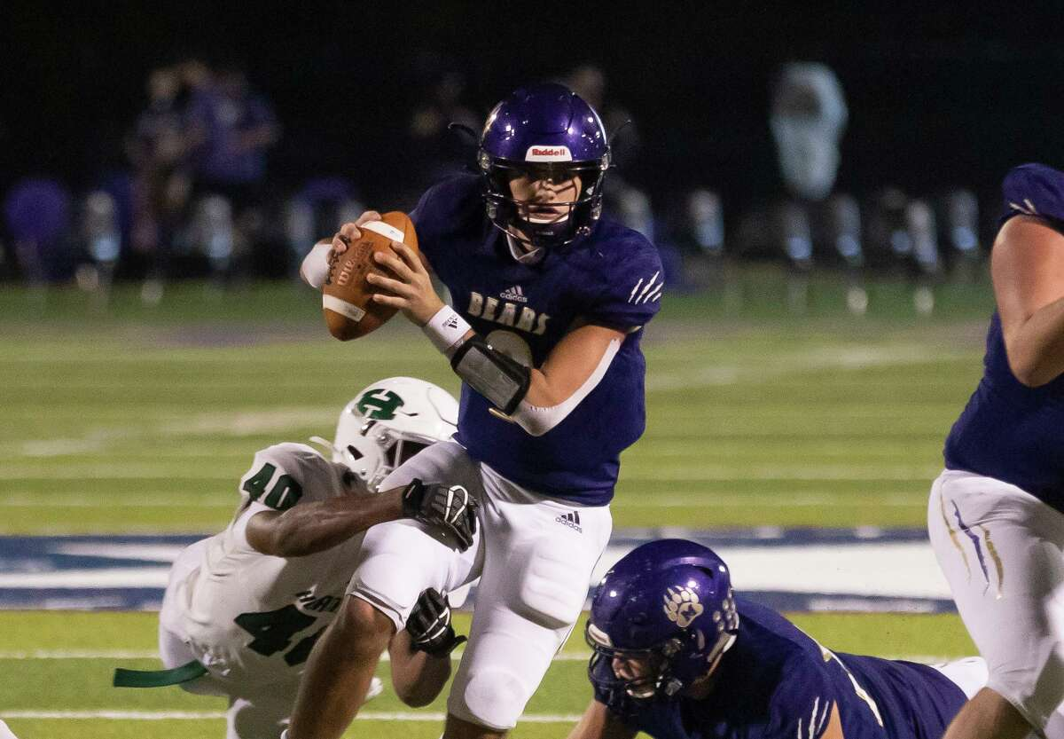 Montgomery quarterback Brock Bolfing (9) is tackled by Huntsville defensive end Quaterian Riles (40) during the fourth quarter of a District 10-5A (Div. II) football game at Montgomery ISD Stadium, Friday, Nov. 27, 2020, in Montgomery.