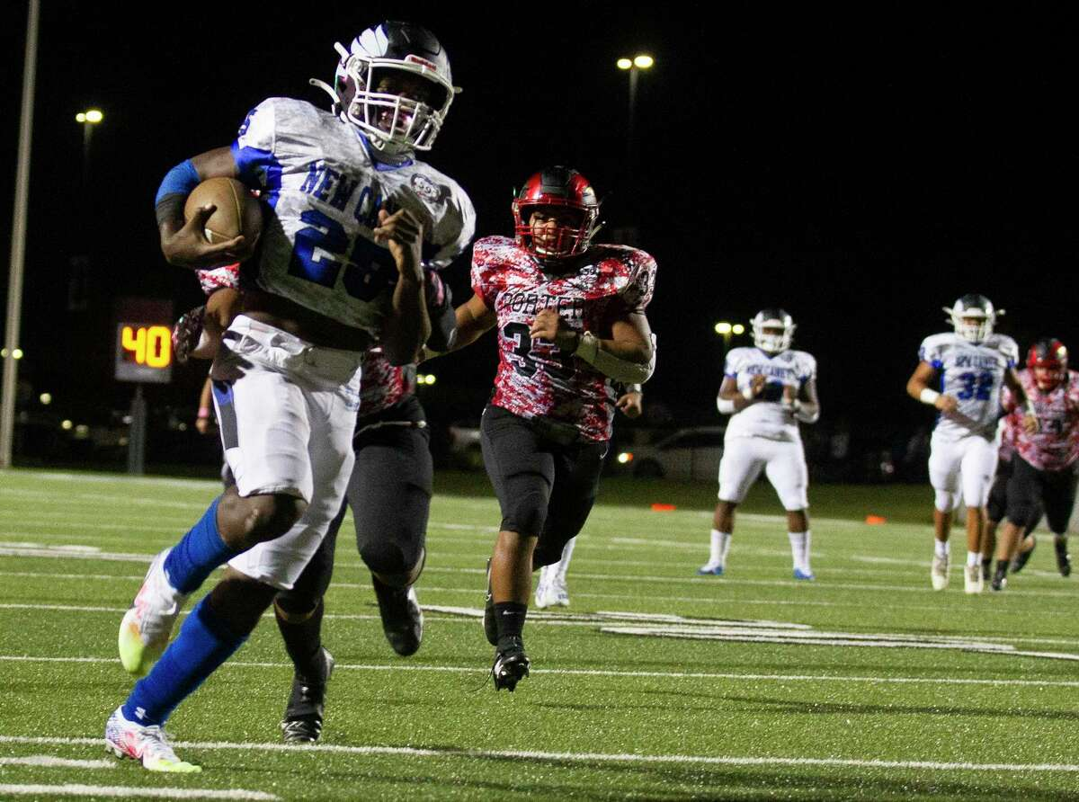 New Caney running back Kedrick Reescano (25) picks up a 62-yard gain during the first quarter of a District 8-5A high school football game at Randall Reed Stadium, Friday, Oct. 9, 2020, in Porter.