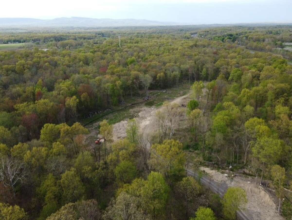 Anthony Dirago and Tina Bucci have proposed adding a drag racing strip to their large Plattekill property, a parcel that spans more than 40 acres. Neighbors are fighting it.