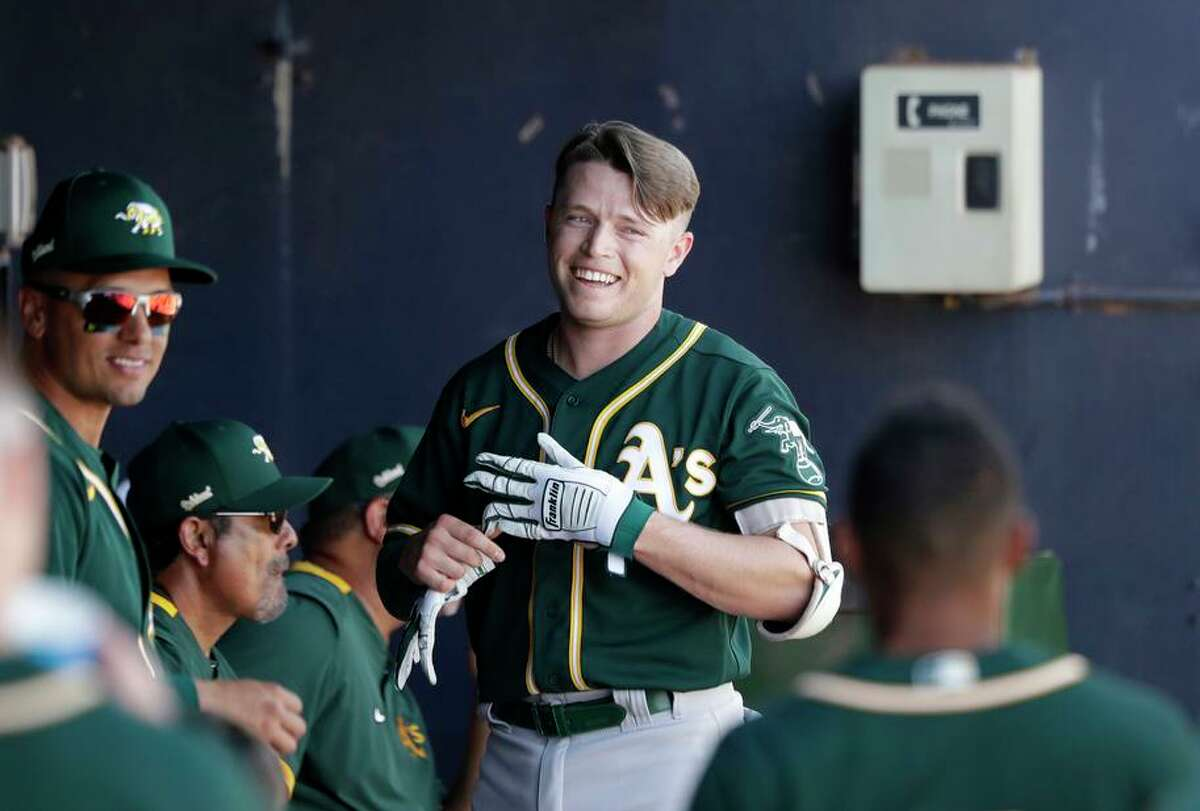 Oakland Athletics' Nick Allen smiles in the dugout after hitting a solo home run against the Seattle Mariners in the third inning during a spring training baseball game Saturday, March 7, 2020, in Peoria, Ariz. (AP Photo/Elaine Thompson)