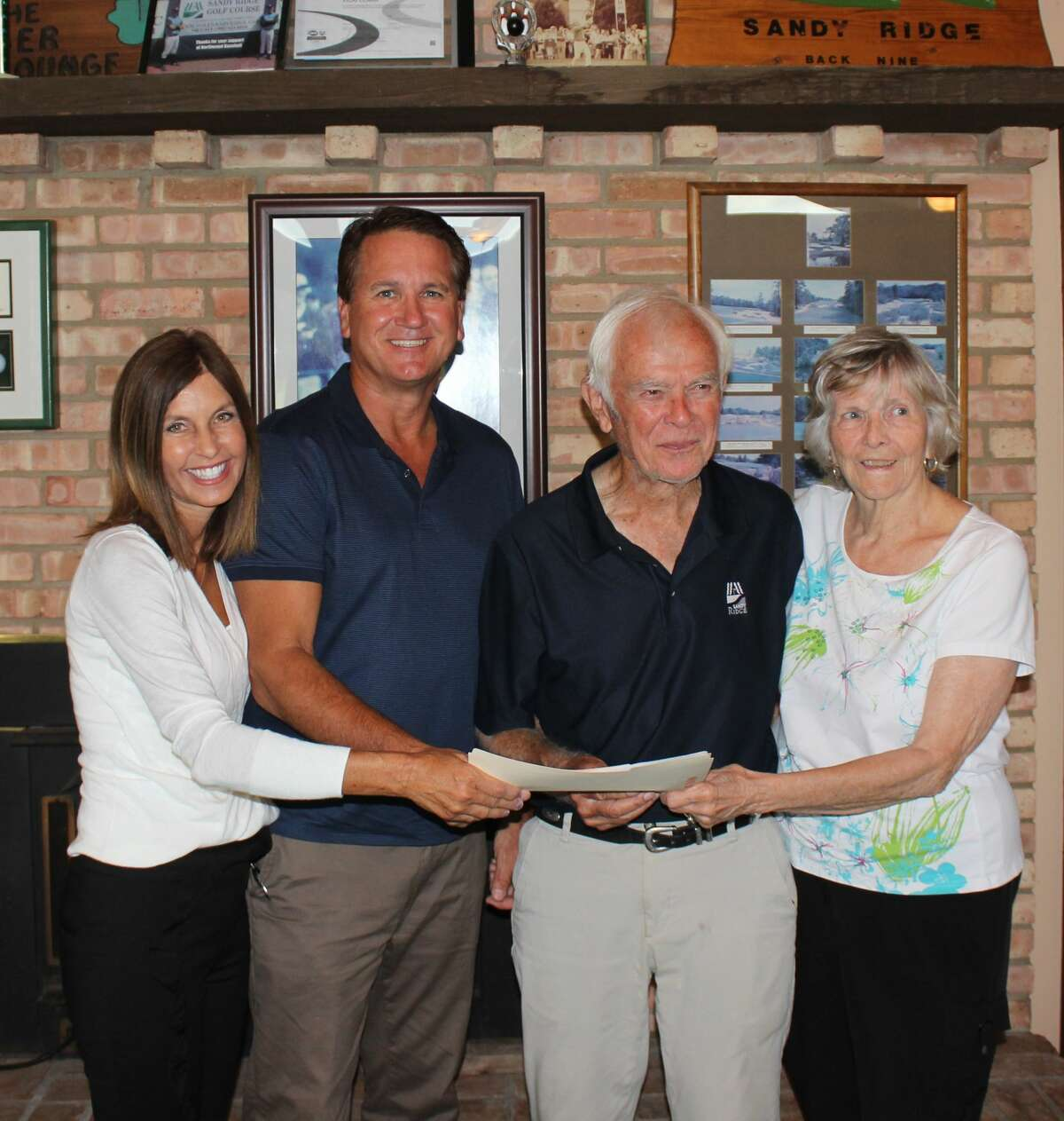 Luanne and Greg Grocholski (left) have purchased Sandy Ridge Golf Course from Ed and Patricia Clark (right) and are slated to take over operations of the facility soon.