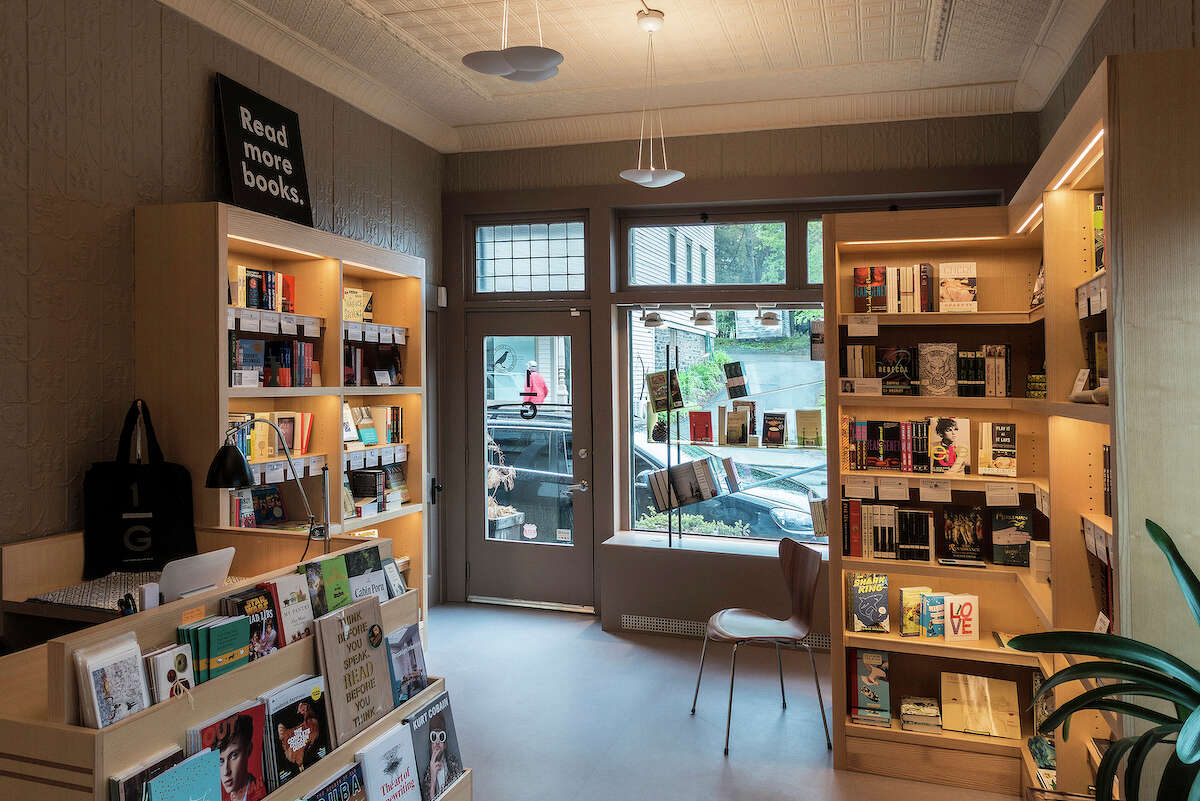 """One Grand's shelves feature the """"desert island"""" book picks of celebrities and well-known figures. It's an unexpected way to discover a new read while also offering """"a kind of intimacy with that person,"""" said owner Aaron Hicklin, """"like you were discovering something about them through the choices they made."""""""