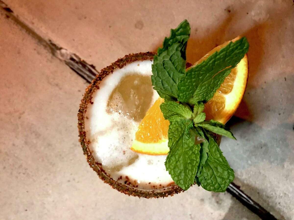 The La Gata cocktail at SoHo Wine & Martini Bar has tequila, pineapple, spice and orange.