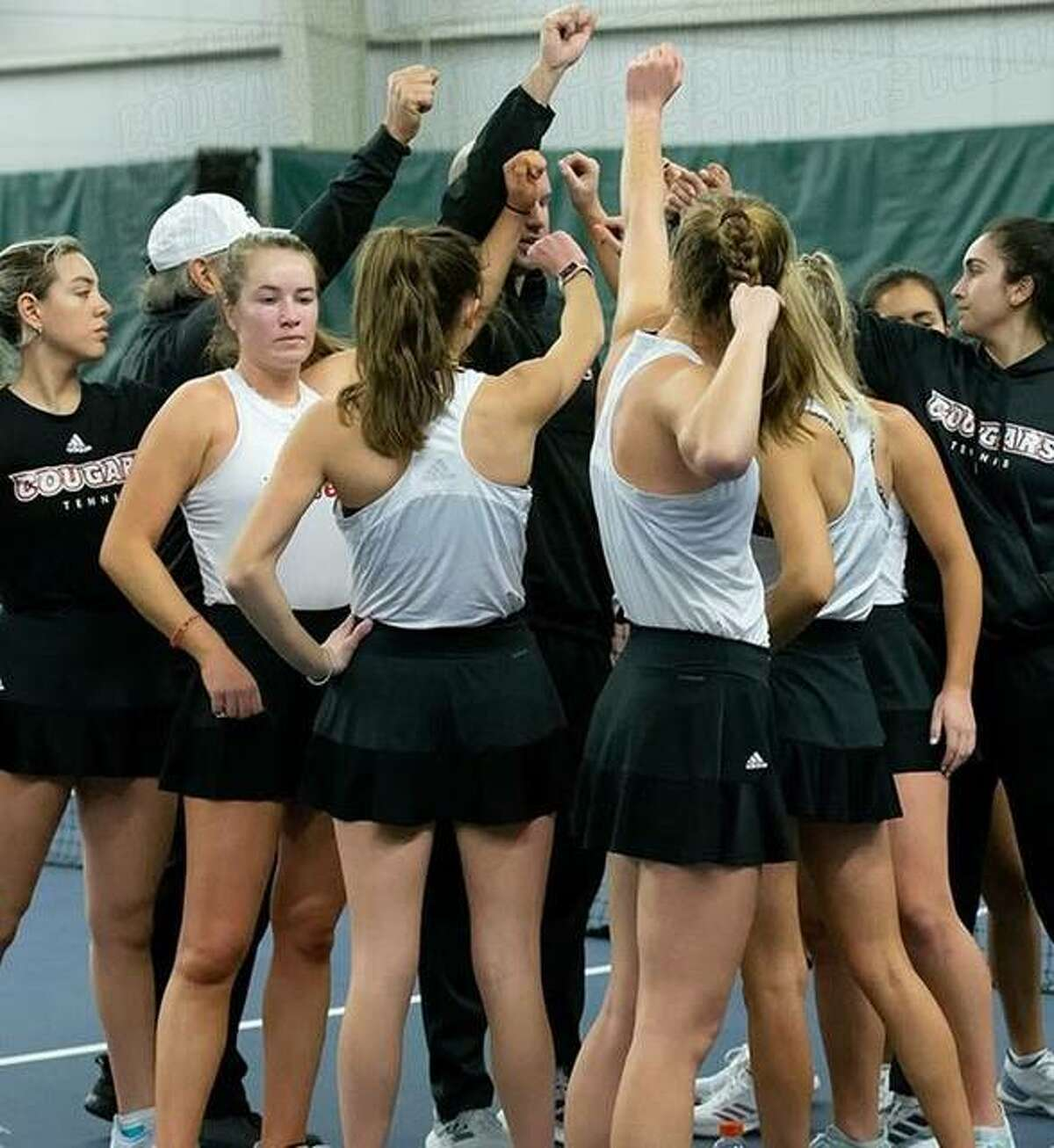 Members of the SIUE women's tennis team celebrate last season. The SIUE women's tennis program has been awarded 2021 All-Academic Team honors from the Intercollegiate Tennis Association.