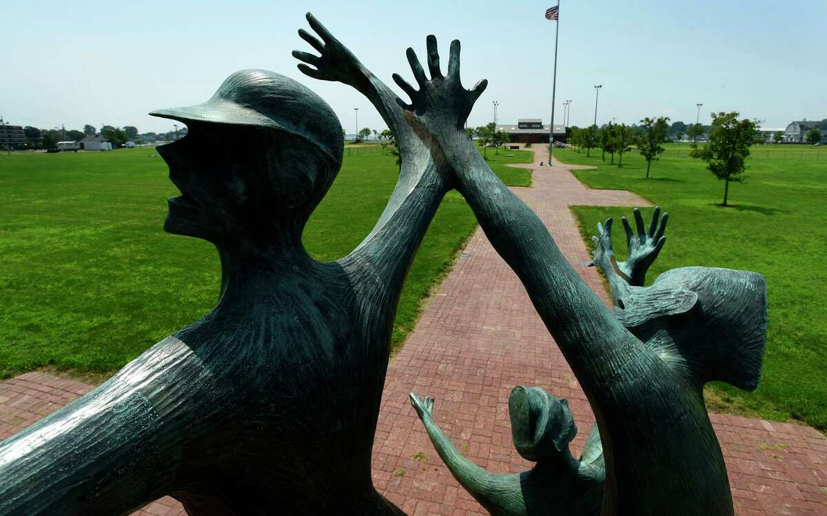 """The area where there is a proposal to add a Purple Heart monument scen through the statue called """"Denial of War"""" at Veteran's Park Friday, July 16, 2021, in Norwalk, Conn."""