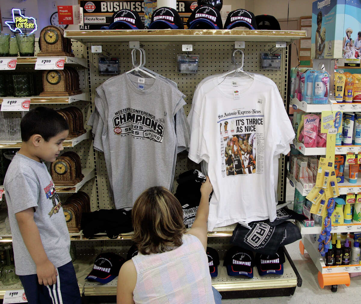 Hugo Guillen, 5, and his mother Nancy Guillen sort through Spurs T-shirts at the Olmos Park H-E-B Saturday, June, 2005.